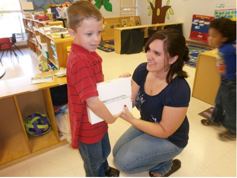 Ethan receives his iPad from Miss Jessica